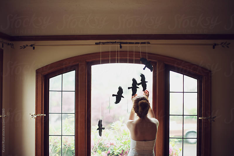 Hanging Up Birds by Kevin Russ for Stocksy United