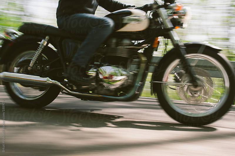 Man Riding Motorcycle by Branislav Jovanovic for Stocksy United