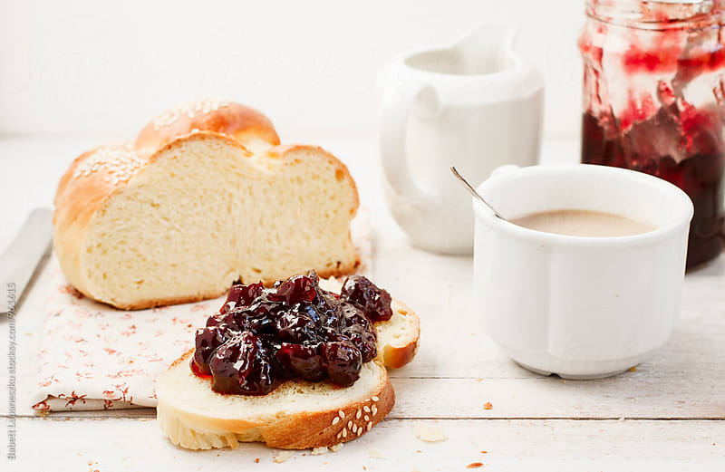 Breakfast challah with cranberry jam and coffee by Viktorné Lupaneszku for Stocksy United