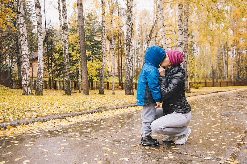 Mother kisses her little boy by Danil Nevsky for Stocksy United