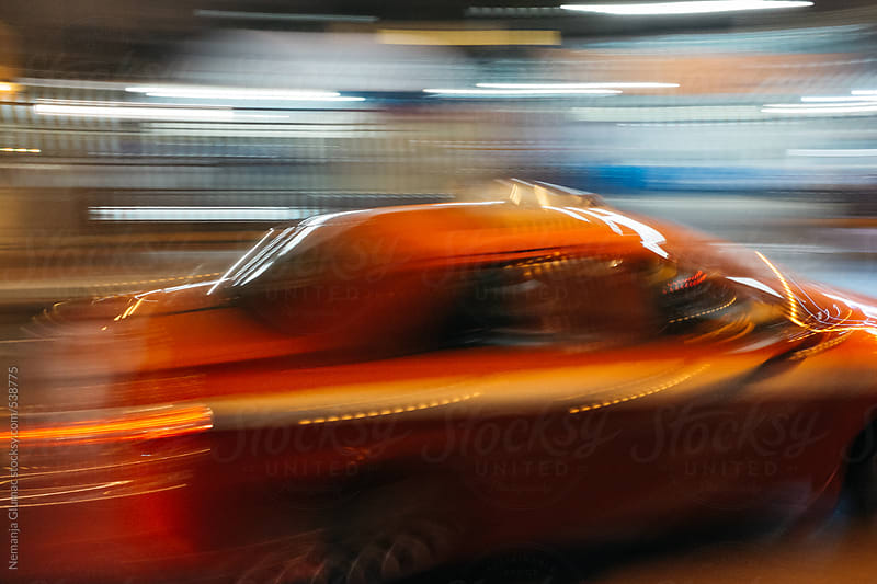 Orange Taxi in Bangkok in Full Speed   by Nemanja Glumac for Stocksy United