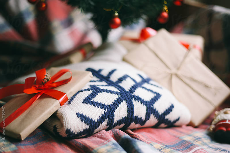 Christmas presents and sweater below the Christmas tree  by Marija Mandic for Stocksy United
