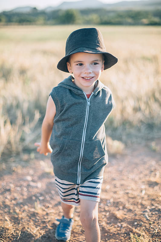 Portrait : A child having fun in the countryside by Lydia Cazorla for Stocksy United