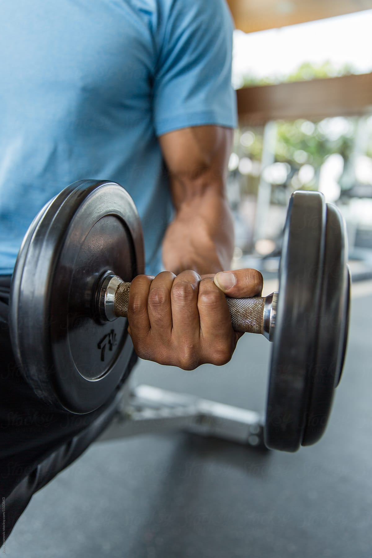Black man working out at the gym - lifting weights by Jovo Jovanovic for  Stocksy United