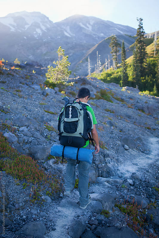 Male hiker on trail by Linzy Slusher for Stocksy United