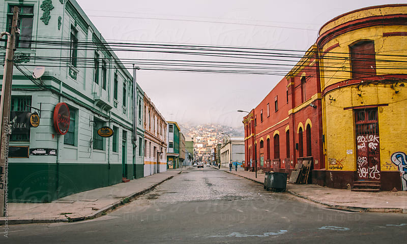 Colorful buildings and street in city, Valparaiso, Chile by Alejandro Moreno de Carlos for Stocksy United