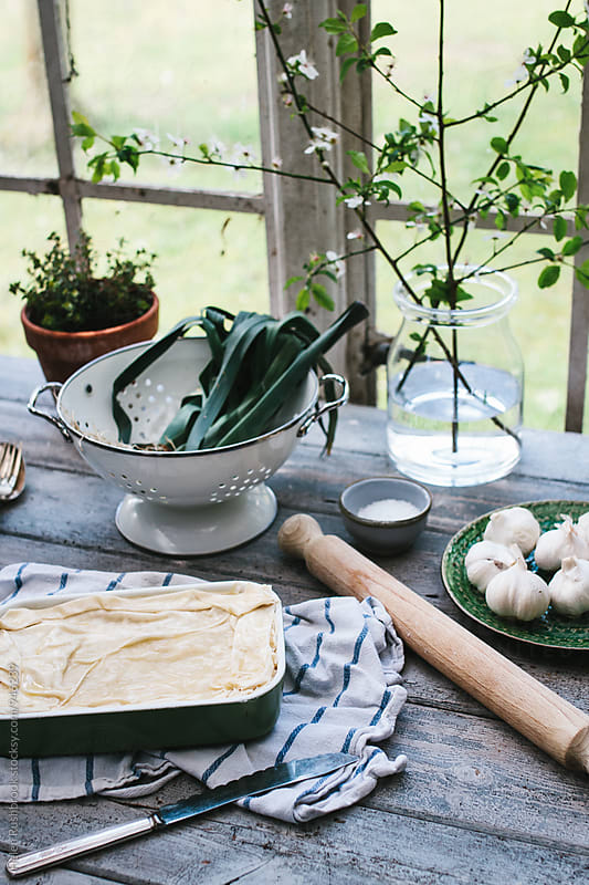 Kitchen scene with a filo pie ready for baking. by Helen Rushbrook for Stocksy United