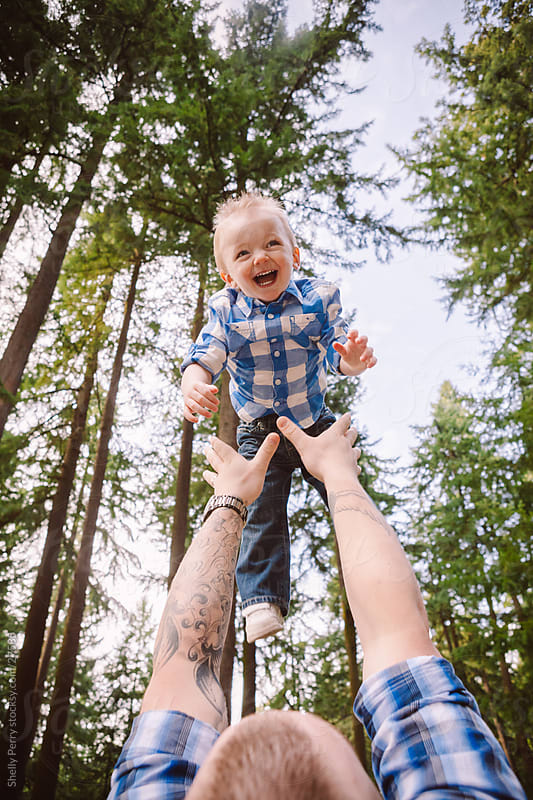 Toddler Catches Air as his Dad Playfully Throws Him Towards the Sky by Shelly Perry for Stocksy United