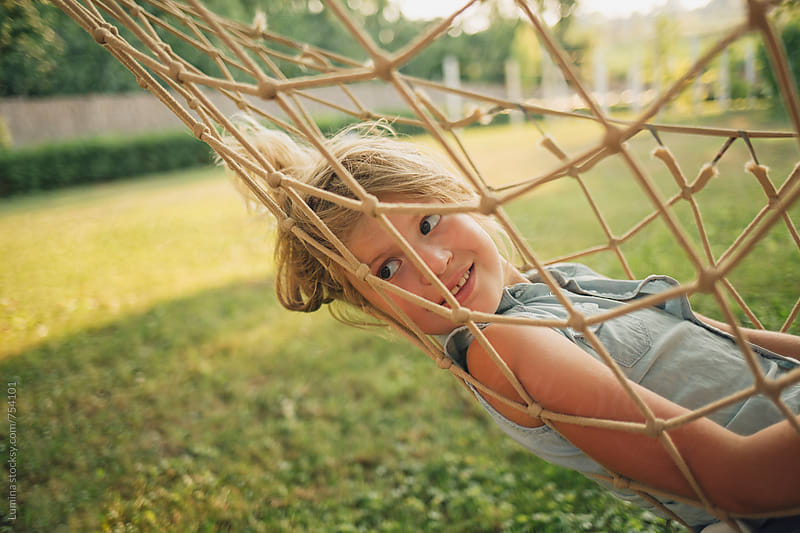 Girl Relaxing in a Hammock by Lumina for Stocksy United