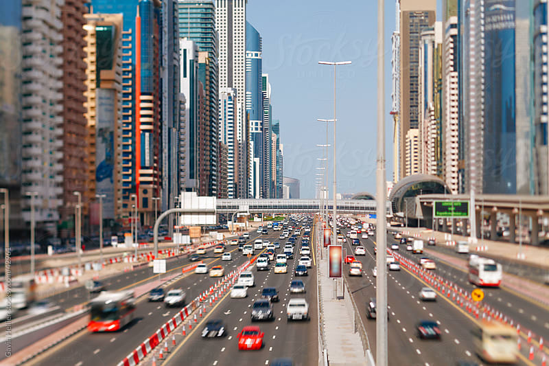 United Arab Emirates, Dubai, Sheikh Zayed Rd, traffic and new high rise buildings along Dubai's main road by Gavin Hellier for Stocksy United