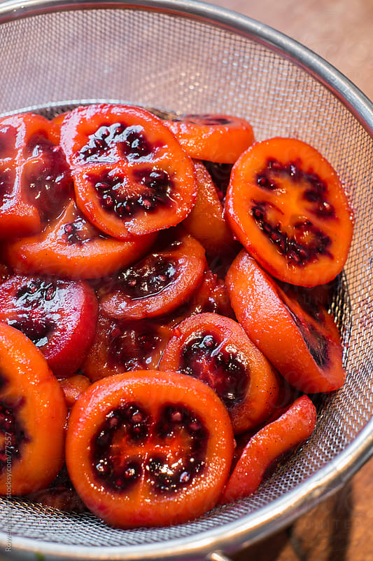 Tamarillos Poached in Vanilla Syrup by Rowena Naylor for Stocksy United
