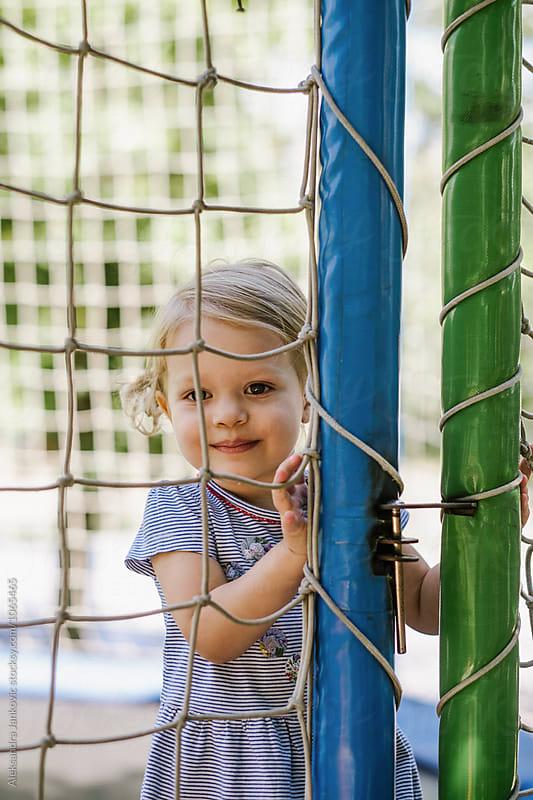 Baby Girl on the Trampoline by Aleksandra Jankovic for Stocksy United
