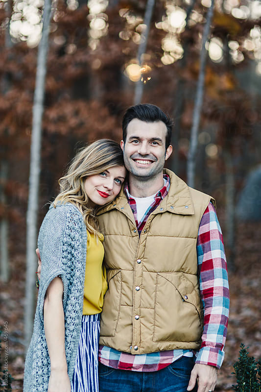 Fashionable hipster couple standing in a forest by Jakob for Stocksy United