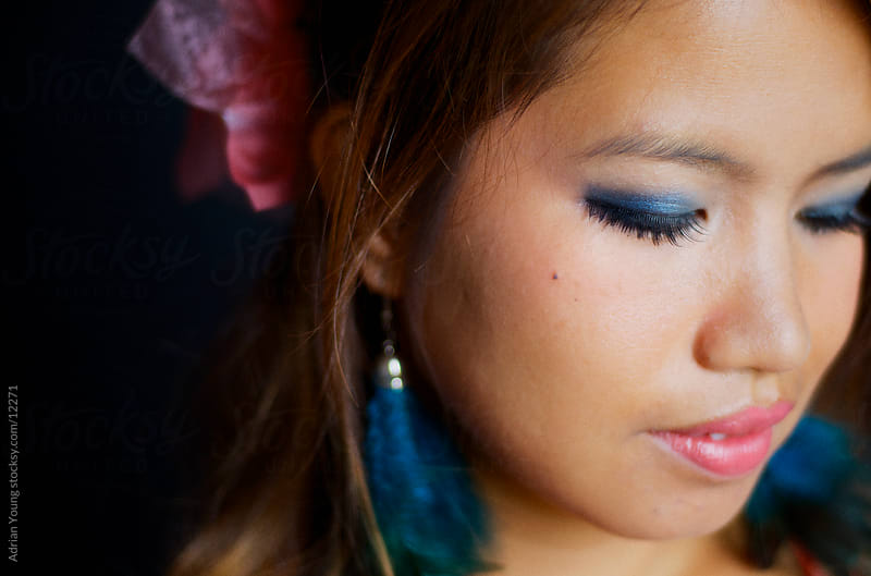 Closeup Portrait of a Young Thai Woman by Adrian P Young for Stocksy United