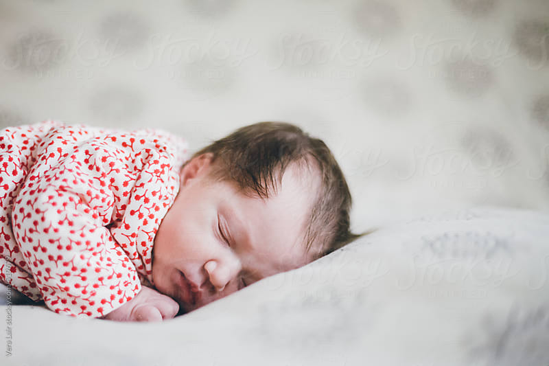 Newborn baby girl by Vera Lair for Stocksy United
