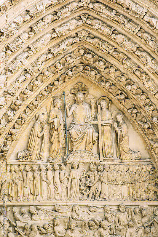 Closeup view of sculptures at the Notre Dame church in Paris by Peter Wey for Stocksy United