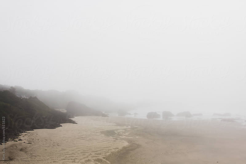 Beach in fog by Kim Jay for Stocksy United