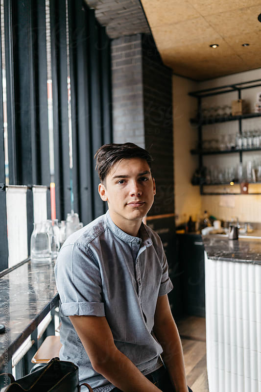 Portrait of a man in a coffee shop by Melanie Riccardi for Stocksy United