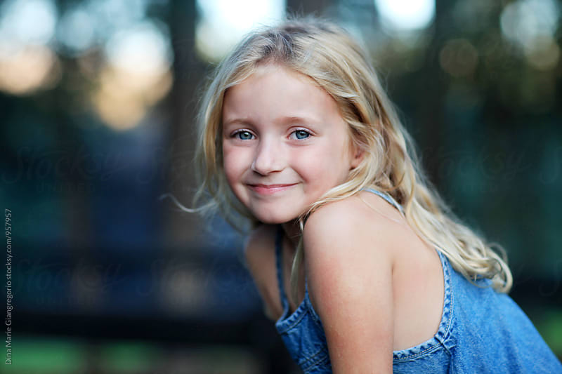 Outdoor Portrait Of  Blonde Girl Wearing Denim Dress by Dina Giangregorio for Stocksy United