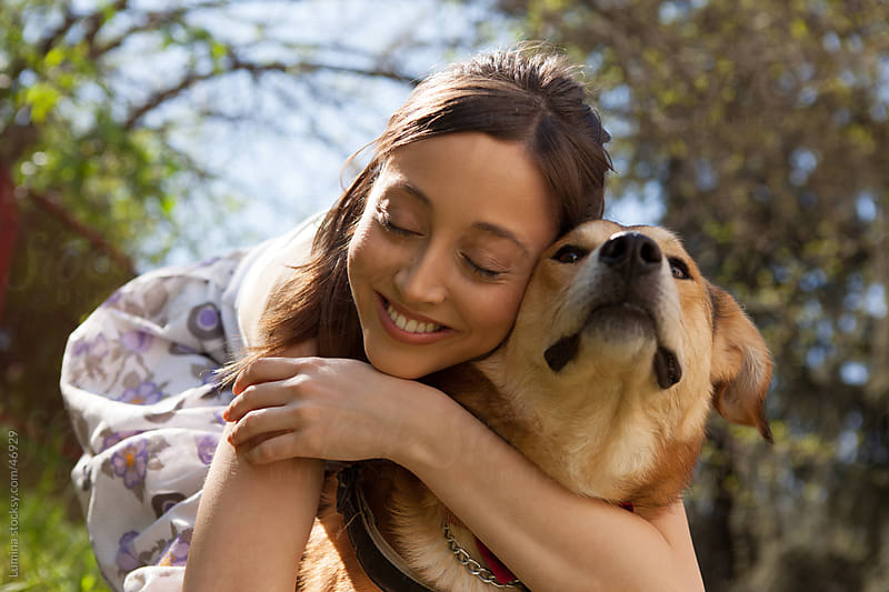 Woman Hugging Her Dog by Lumina for Stocksy United