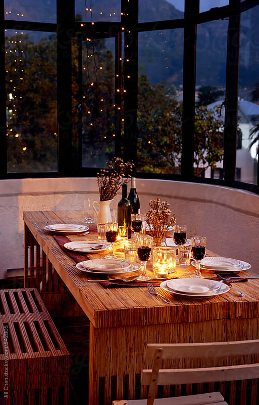 Dinner party table setting  by Jill Chen for Stocksy United