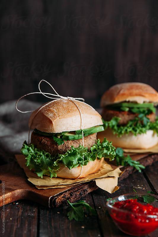 Quinoa and beans burger with avocado by Nataša Mandić for Stocksy United