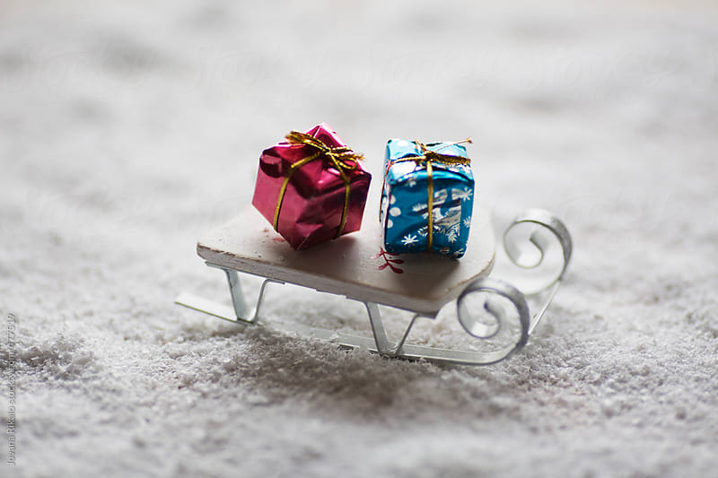 Miniature sledge and Christmas gifts by Jovana Rikalo for Stocksy United