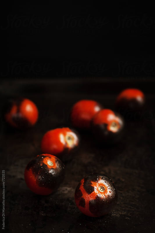 Black cherry tomatoes by Federica Di Marcello for Stocksy United