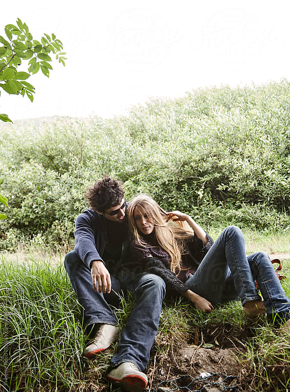 Couple relaxing in nature together in California  by Trinette Reed for Stocksy United