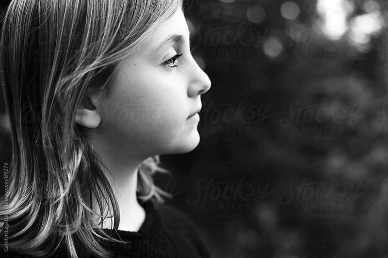 Profile of a young girl looking forward by Carolyn Lagattuta for Stocksy United