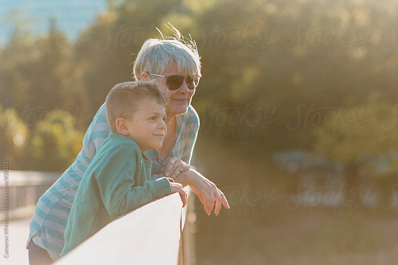 Grandmother and grandson bonding by Cameron Whitman for Stocksy United