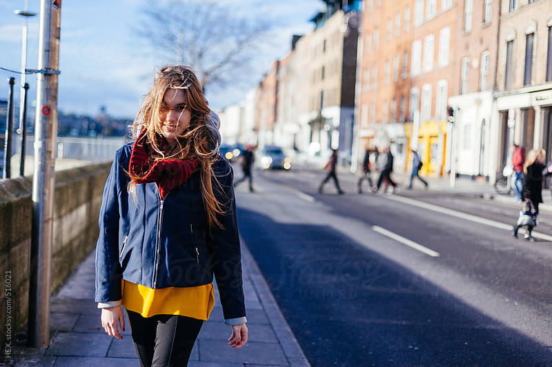 Young Blonde Woman Walking on the street . Dublin City by HEX. for Stocksy United