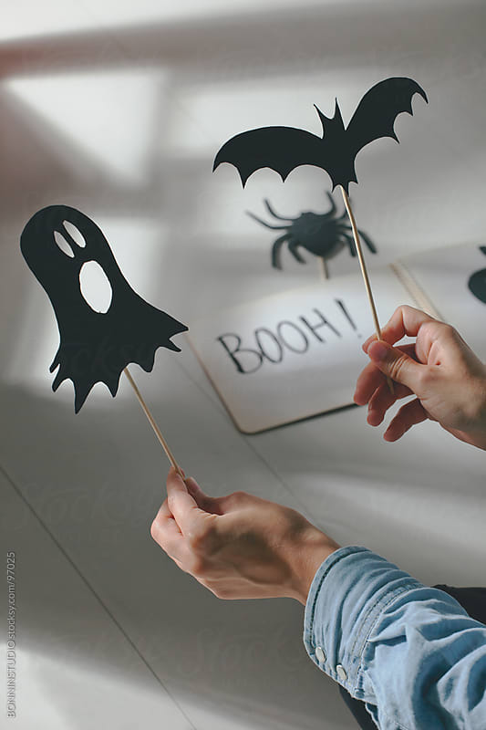 Halloween decoration. Girl making terrifying shadow puppet. by BONNINSTUDIO for Stocksy United