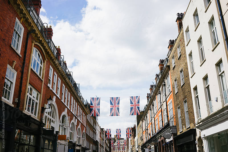 Union jacks on a central London shopping street by Kirstin Mckee for Stocksy United