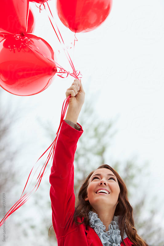 Valentine's: Holding A Bunch Of Ballons Outside by Sean Locke for Stocksy United