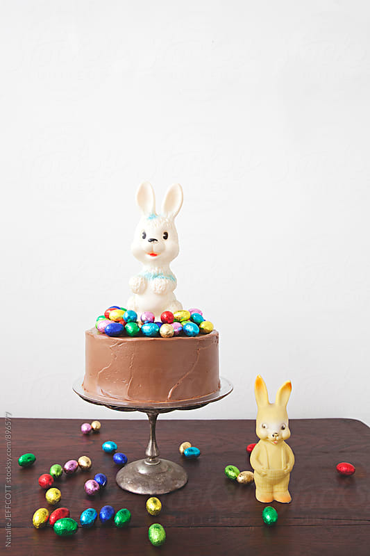 Decorated chocolate cake, with chocolate easter eggs and toy bunny rabbit by Natalie JEFFCOTT for Stocksy United