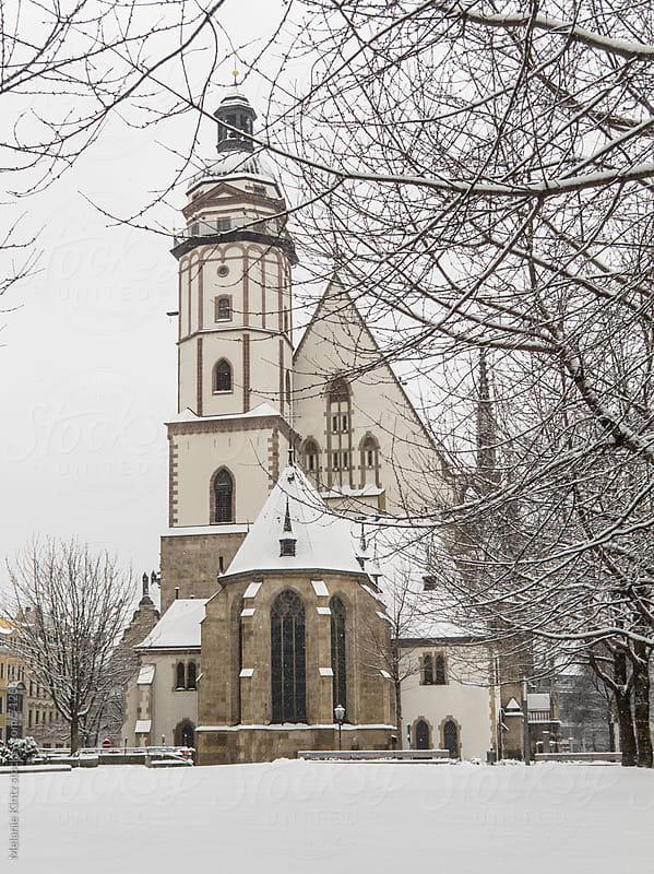Leipzig's St. Thomas church in winter by Melanie Kintz for Stocksy United