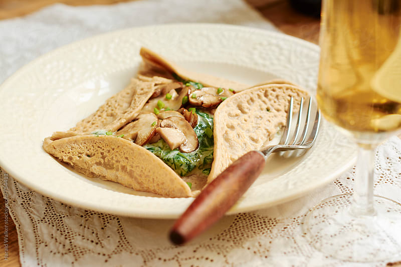 Spinach mushroom buckwheat crepes by Harald Walker for Stocksy United