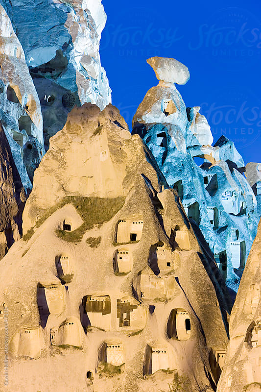 Old troglodytic cave dwellings cut into the rock Castle of Uchisar, illuminated at night, Cappadocia, Anatolia, Turkey, Asia Minor, Eurasia by Gavin Hellier for Stocksy United