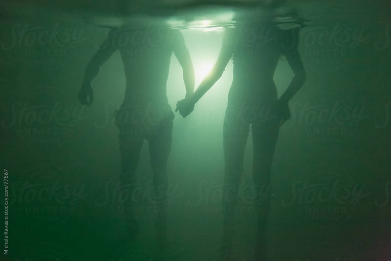 Couple underwater by michela ravasio for Stocksy United