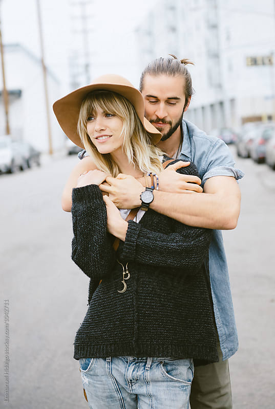 Couple hanging out in the city by Emmanuel Hidalgo for Stocksy United