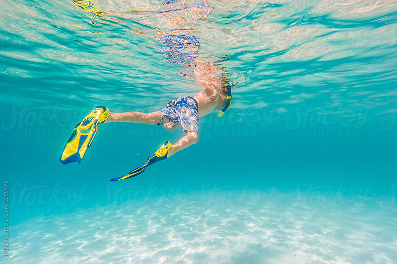 Little Boy Swimming Snorkeling Underwater at All Inclusive Caribbean Resort White Sand Beach by JP Danko for Stocksy United