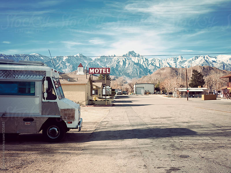 Small Town Road Surrounded By Mountains by Laura Austin for Stocksy United