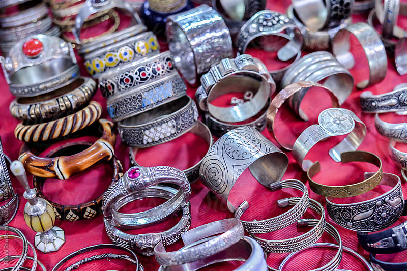 Silver bracelets in the souk of Marrakech by Bisual Studio for Stocksy United