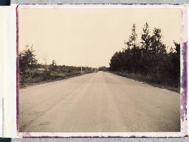 An Empty Road Photographed On Expired Polaroid Chocolate Film by ALICIA BOCK for Stocksy United
