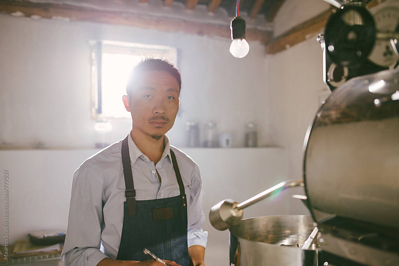 Man working on coffee roasting workshop by Maa Hoo for Stocksy United