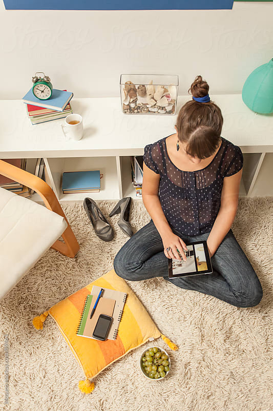 Woman Sitting on the Floor and Using Tablet by Mosuno for Stocksy United