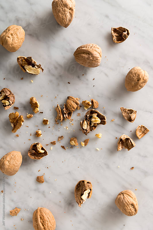 Walnuts Cracked Open From Above by Jeff Wasserman for Stocksy United
