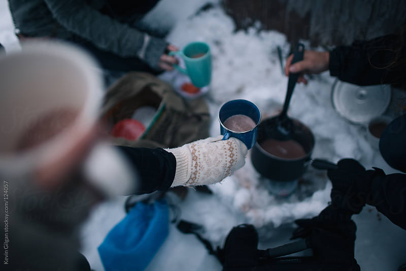 Hot Cocoa in the Snow by Kevin Gilgan for Stocksy United