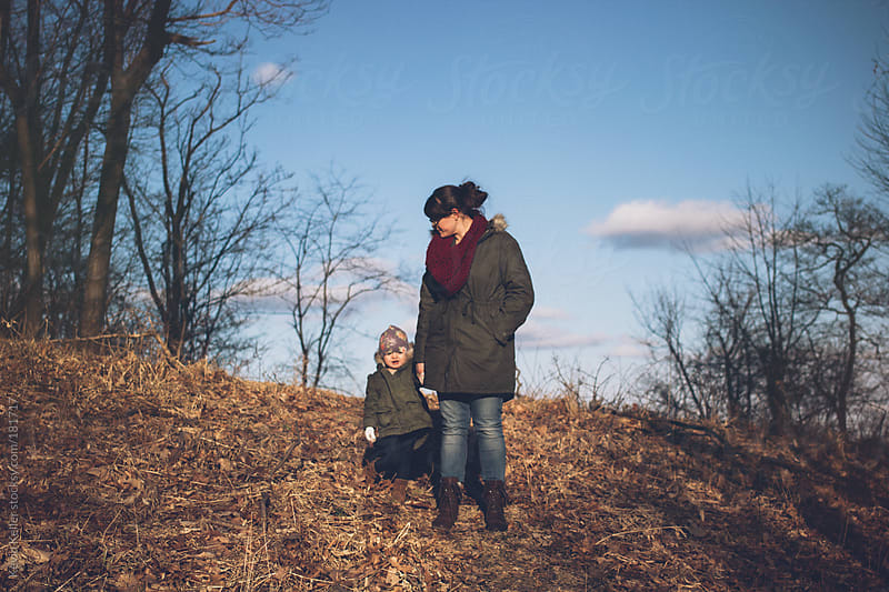 Mother and Daughter Hiking on a Hillside by Kevin Keller for Stocksy United